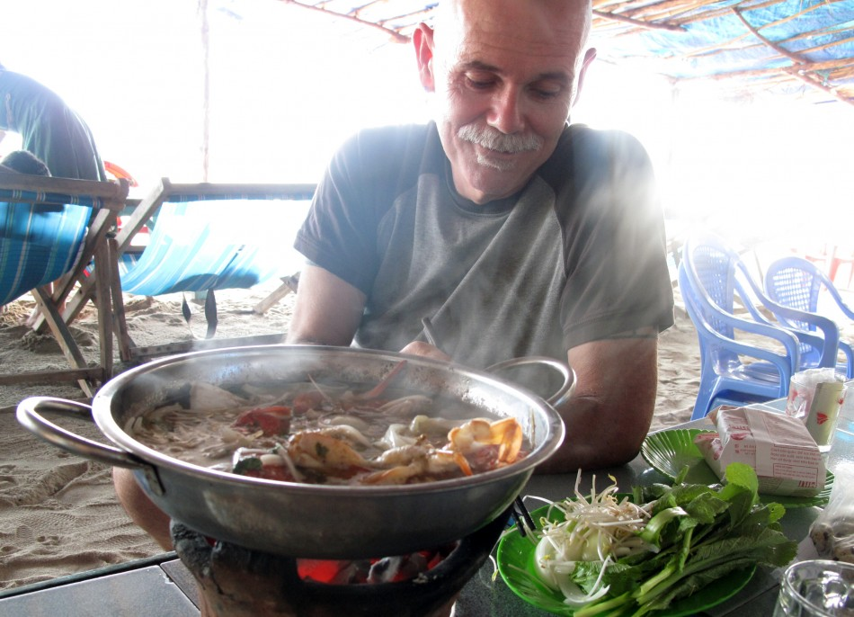 Doc, enjoying a hot pot on Bai Dai Beach.