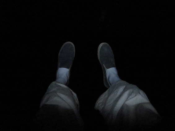 Feet, lit by a headlamp 100ft above the jungle.